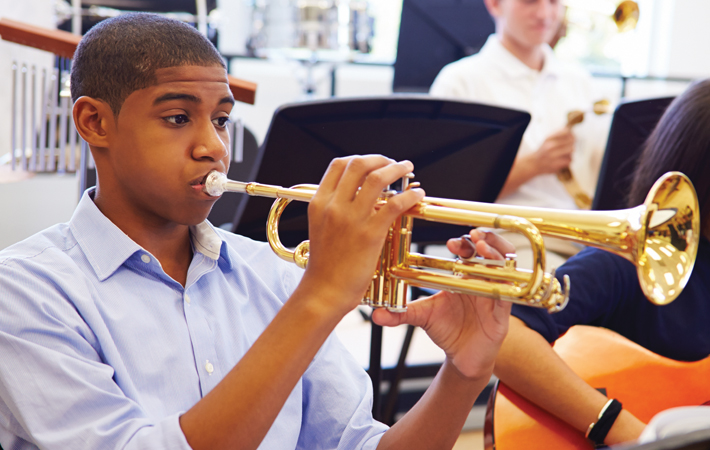 a radford trust student playing a trumpet